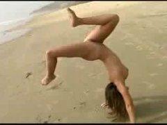 Acrobatic excersizes at nudist beach