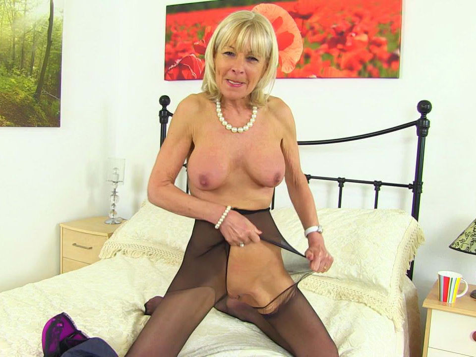image English gilf elaine sticks a badminton racket up her pussy