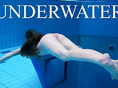 Sexy girl shows magnificent young body underwater