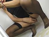Blonde tgirl in black stockings peeing on her own feet