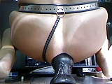 Huge anal butt plug in skirt and chastity